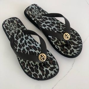 Tory Burch rubber brown and gold logo flip flops